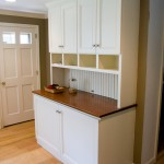 Custom built-in cabinet to enclose a washer and dryer | West Hartford, CT