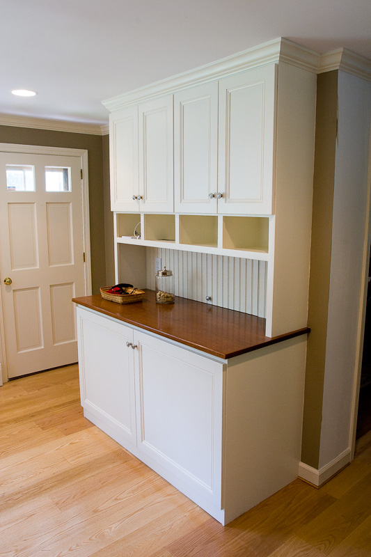 Custom built-in cabinet to enclose a washer and dryer in West Hartford, CT.