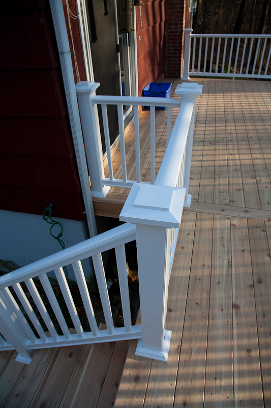 A composite deck railing and western red cedar decking in Storrs, CT.