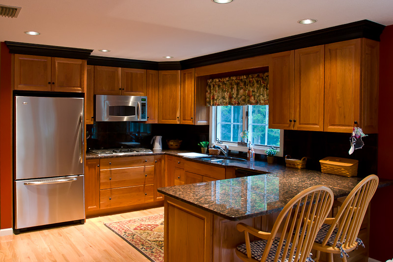 Image of a complete kitchen remodeling job with cherry cabinets and granite counter tops | Rocky Hill CT