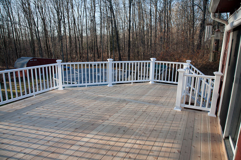 Red cedar deck with a composite railing in Mansfield, Ct.