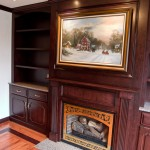 Custom cherry built-in cabinetry with a fireplace mantle and library cabinets. Glastonbury, CT