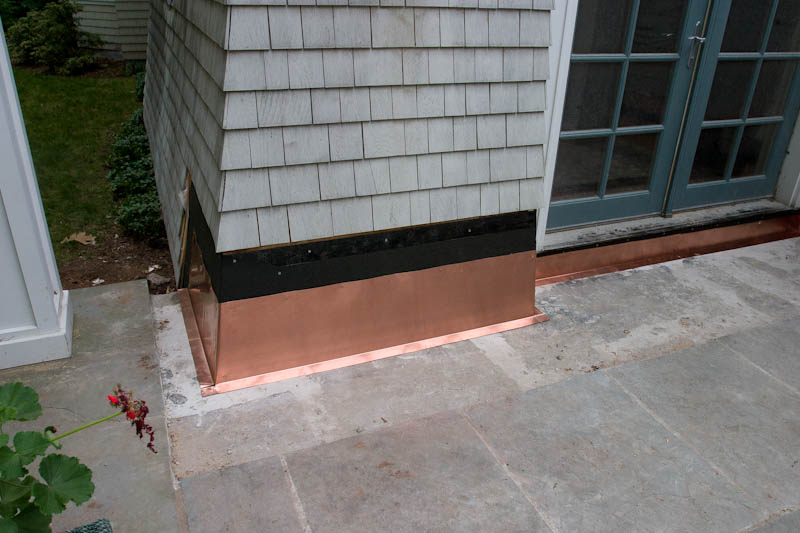 Repairing flashing on a bluestone covered concrete patio with copper. Avon, CT