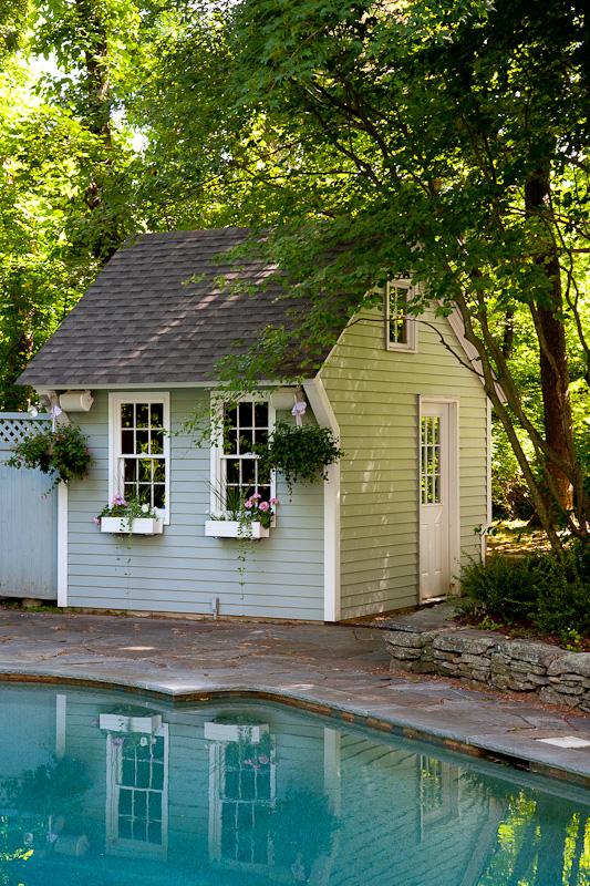 A light gray pool house in Farmington, CT