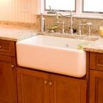 Cherry kitchen cabinets with a white farm sink in Glastonbury, CT