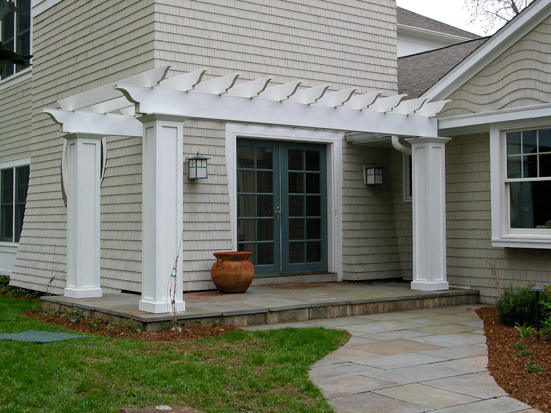 Entry pergola and white cedar sidewall shingles in Avon, CT