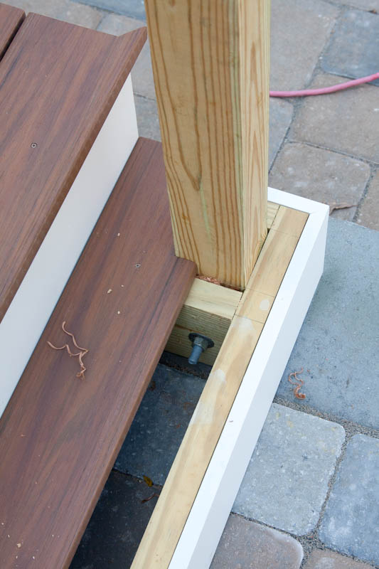 Detailed image of a newel post installation on a porch or deck. This job is in Glastonbury CT.