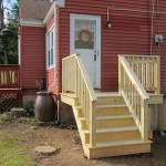 A pressure treated deck with stairs in Coventry, Ct