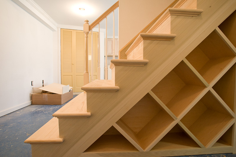 A new set of stairs with a custom built wine rack for a finished basement project in Glastonbury, CT