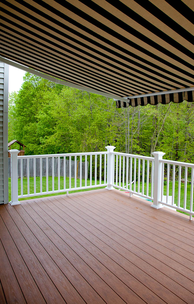 An awning covers a composite deck in Rocky Hill, CT.