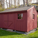 A custom built cedar shed stained barn red.
