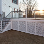 Composite deck in Hebron CT with vinyl privacy lattce.