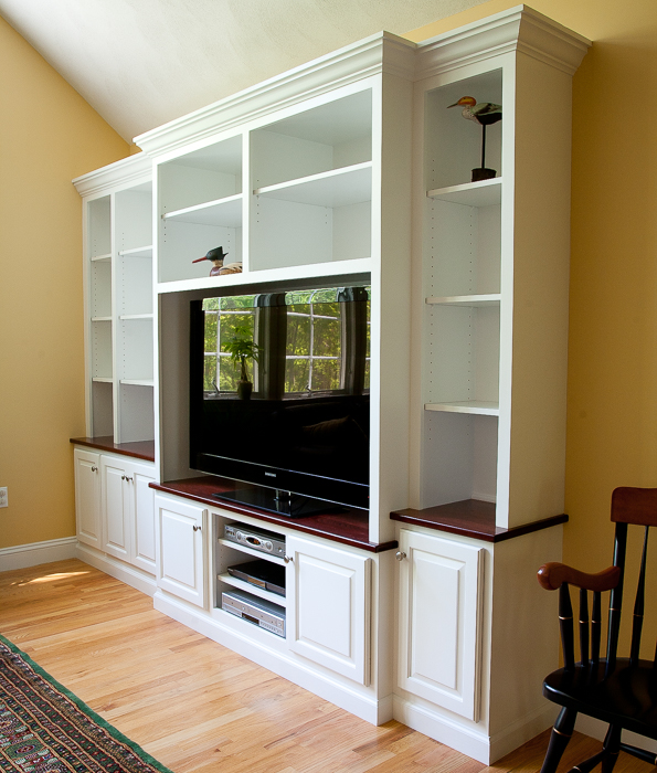 Custom built-in cabinet painted white with solid cherry counter tops.