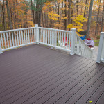Picture of a deck resurfaced with dark brown composite decking boards.